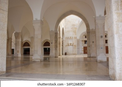Jerusalem / Palestine - February 18th 2014:  of King Hussain Bin Talal Mosque in Amman, Jordan. Stunning white stoned prayer hall and courtyard with arched pillars.