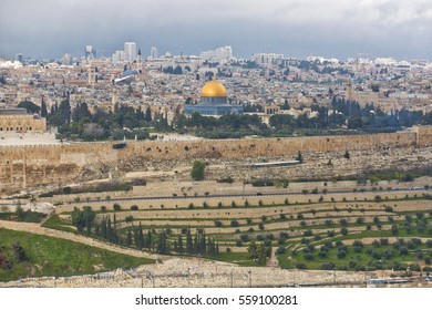 JERUSALEM, PALESTINE/ISRAEL - March 20, 2016 - View of the old city of Jerusalem and the Dome of Rock from Mount of Olives with morning storm clouds on the horizon.