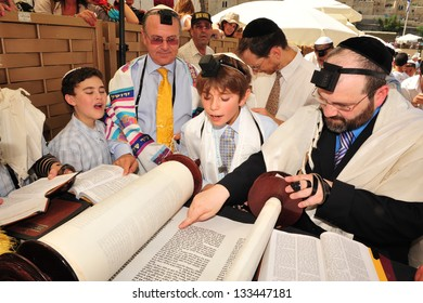 JERUSALEM -SEP 22 2008: Bar Mitzvah ritual at the Wailing wall in Jerusalem, Israel.Boy who has become a Bar Mitzvah is morally and ethically responsible for his decisions and actions.