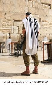 JERUSALEM - September 27: A member of Israel's military visits Jerusalem's Western Wall on September 27, 2015 in Jerusalem.