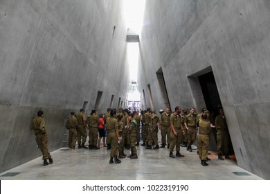 JERUSALEM - September 7, 2014: Conscripts from the Israeli Defense Forces visit the prism-shaped walkway between galleries at Yad Vashem, Israel's official memorial to the victims of the Holocaust.