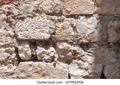 Jerusalem. The Wailing Wall of ancient white bricks with scraps. Israel, 16 June 2010.