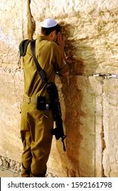 JERUSALEM/ISRAEL - April 2, 2012 : Jewish soldier praying at the Western wall or Wailing wall in Jerusalem, Israel.