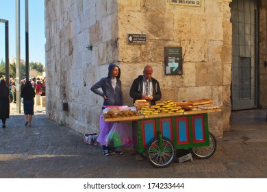 JERUSALEM,ISRAEL - JANUARY 25:Two muslim men selling pastry and bread on January 25,2014 in Jerusalem.The scene taken in the Jaffa gate which is the most famous of the eight gates of the City.