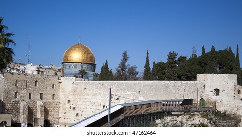 jerusalm western wall and golden mosque blue sky