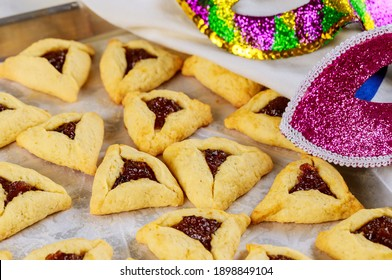 Jerwish food Hamantaschen cookies with jam, tallit and mask for Purim.