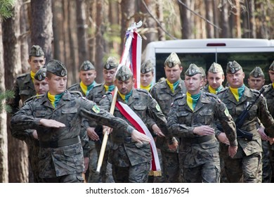 Jerzyska, Poland, Sept 18: Unidentified soldiers at the outdoor anniversary mass- place where AK soldiers was  shooten, september 18, 2013 in Jerzyska, Poland.