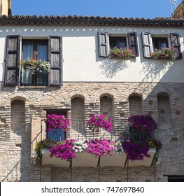 Jesi (Ancona, Marches, Italy): old typical house along the historic walls with flowers