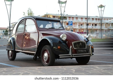 JESOLO, ITALY - AUGUST 23, 2012: Classic 1950s Citroen 2CV car on the Italian street