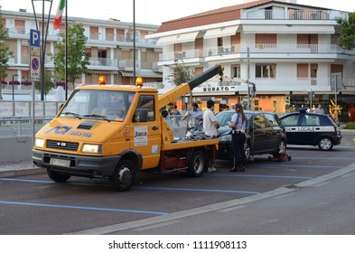 JESOLO, ITALY - JUNE 14, 2012: Italian tow truck at work with police car. Volkswagen Golf car evacuation.