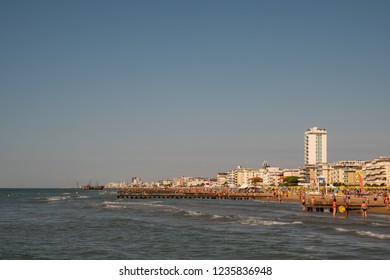 Jesolo Lido / Italy - August 16 2018: View of the city with the beach crowded with tourists in summer, Veneto, Italy