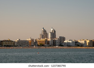Jesolo Lido / Italy - August 16 2018: City view from the sea with skyscrapers at sunset
