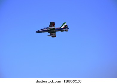 Jesolo lido, Italy – sep 09 2018: Jet aircrafts acrobatic single of Italy Air Force drawing italian flag figure in the sky