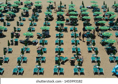 Jesolo, Veneto / Italy - 10th July 2019: tourists and people on the beach on a sunny summer day.