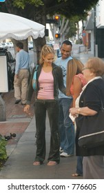 Jessica Alba and her boyfreind have a late lunch in Beverly Hills but find time to pose with her young fan, Los Angeles, Ca, 05/01/04