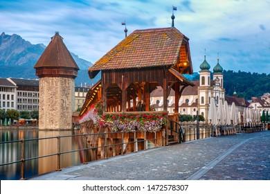 Jesuit Church, Water Tower, Wasserturm, and Chapel Bridge, Kapellbrucke, over the river Reuss in Old Town of Lucerne, Switzerland