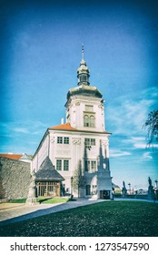 Jesuit College in Kutna Hora, Czech republic. Travel destination. Vertical composition. Analog photo filter with scratches.