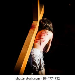 Jesus carrying the Cross into the darkness.Easter concept.
