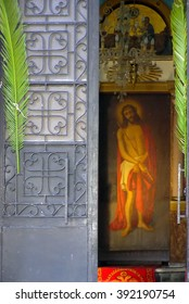 Jesus Christ behind the front church door The full length icon of Jesus Christ as it appears behind the front door of a Greek-Orthodox church