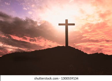 Jesus Christ Concept :  cross on sunset sky background