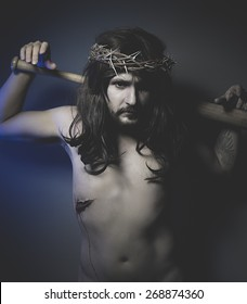 Jesus Christ with crown of thorns and baseball bat