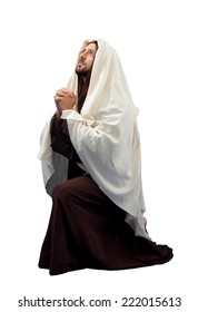 Jesus Christ full lengthin knee  on white background.