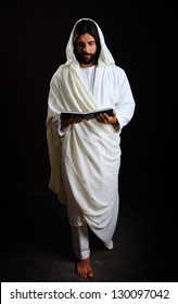 Jesus Christ of Nazareth holding a holy book of prayer