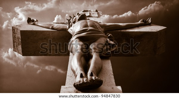 Jesus Christ on the cross in front of a dramatic background