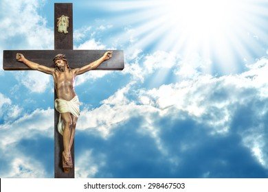 Jesus Christ to paradise: cross of Jesus Christ on sky background with a shining celestial light from above.