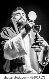 Jesus Christ praying to God consecration the bread and wine in the dark black night