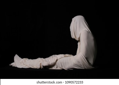 Jesus Christ rising from the dead wrapped in white cloth. Easter Sunday, resurrection of Jesus after three days dead in Jerusalem. Resurrection and Christian concept. Life after death.