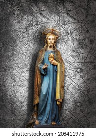 jesus christ statue and wall background