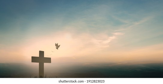 Jesus cross crucifixion on calvary bible in sunrise good Friday risen in easter day morning Sunday concept for Christian praise for holy spirit week God, Catholic church pray star dawn background.