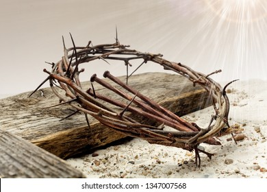 Jesus Crown Of Thorns and cross on sand. Vintage Retro Style.