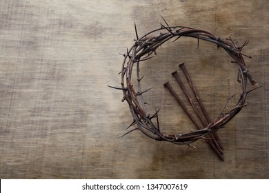 Jesus Crown Thorns and nails on Old and Grunge Wood Background. Vintage Retro Style. Free space for text
