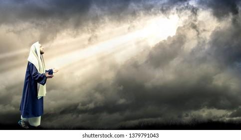 Jesus with Dark Stormclouds with Sunlight Bursting Through