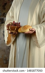 Jesus hands holding grapes and bread at supper