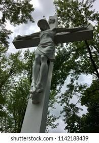 Jesus hanging on the cross sculpture