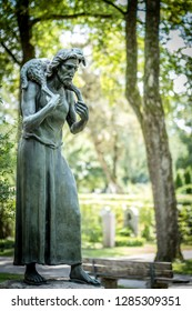 Jesus with lamb Sculpture at Nordfriedhof in Munich