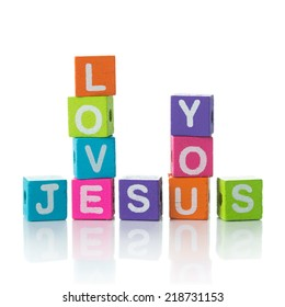 'Jesus love you' sign illustrated with colorful cubes and arranged in crossword style