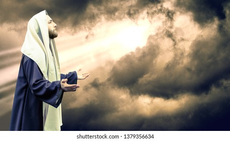 Jesus of Nazareth with Stormclouds with Sunlight Bursting Through