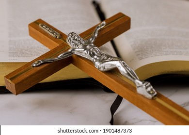 Jesus on way to God through prayer Holy Bible and the crucifix of the Christian cross the hope of mankind for salvation