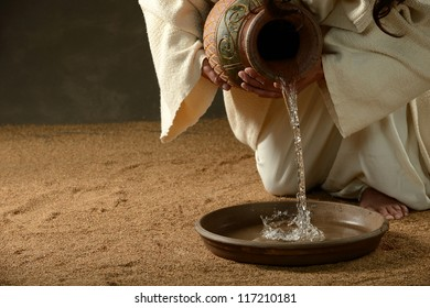 Jesus pouring water from a jug (with copyspace for text)