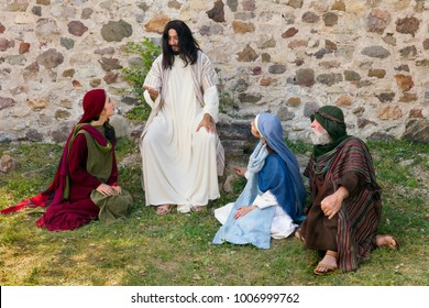 Jesus preaching to a group of people - historical reenactment