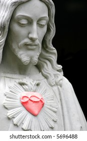 Jesus with a red heart, copy-space, selective color, heart colored red