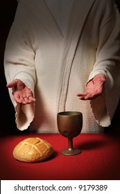 Jesus with scars in his hands at the Communion table with bread and wine