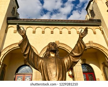 Jesus statue in front of church.