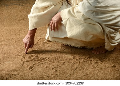 Jesus writing with his finger on the sand