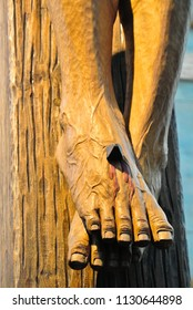 Jesus's feet wood carved  nailed on the cross. Close up wood craft. Symbolic of Christian religion.The pain and death of Jesus.Good Friday and Easter concept.