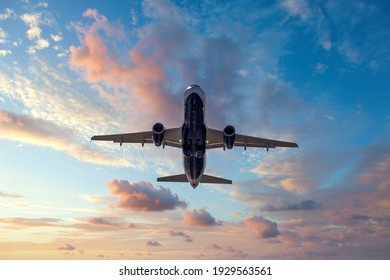 Jet after departing airport at sunset